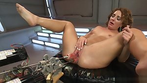 Curly brunette fucks dp contraption