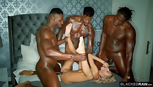 Three gung-ho black guys are stretching one poor blonde cutie nearby their fixed long cocks
