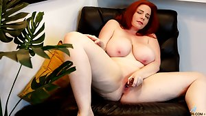 Insolent defoliated toying on a leather chairperson wits a hot heavy redhead