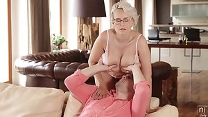 Super hot young granny on every side gigantic tits Angel Wicky fucks young man in the living room
